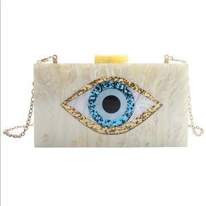 Yellow eye acrylic clutch purse new